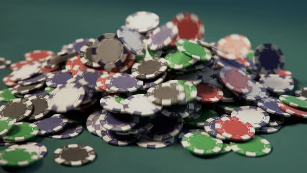 Casino chips falling into a pile Royalty-free stock video