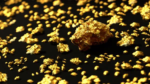 Loopable footage of gold nuggets on round-table Royalty-free stock video