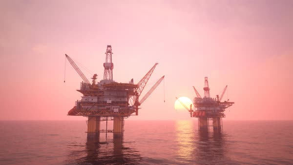 Two offshore platforms or oil rigs at sunset pink sky Royalty-free stock video