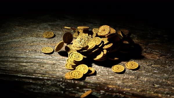 Gold coins falling on the wooden table Royalty-free stock video