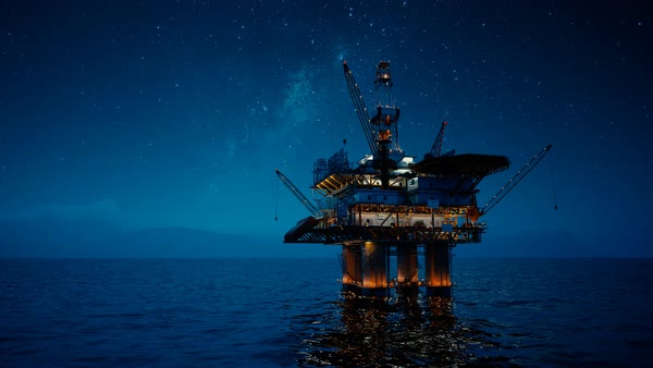 View of an offshore oil rig at night. Milky way shines above. Royalty-free stock video
