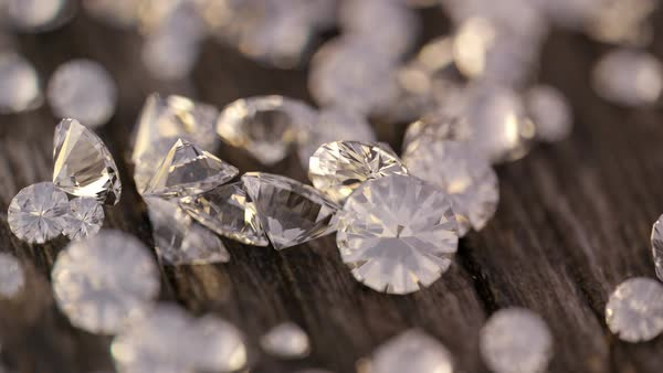 Close-up footage of diamonds falling on wooden table Royalty-free stock video
