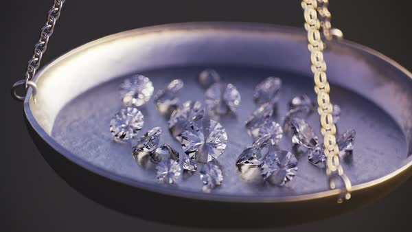 Camera zoom in on a jewellery scale with diamonds. Royalty-free stock video