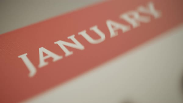 Close-up shot showing year calendar with fast flipping pages Royalty-free stock video