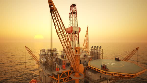 Flying shot of oil rig on the open sea during sunset. Royalty-free stock video