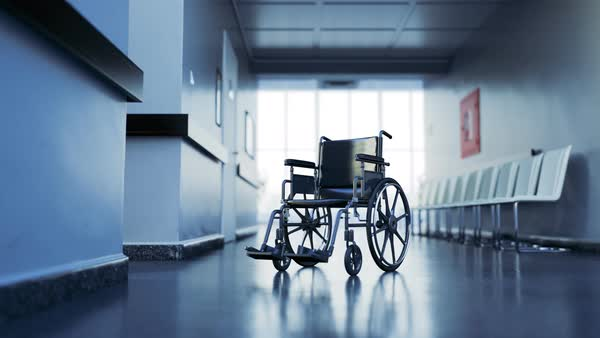 Standard manual wheelchair in empty hospital corridor Royalty-free stock video