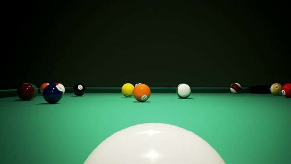 Billiard balls on the green baize of a billiard table. Breaking the rack in pool. Shot from behind the cue ball. Royalty-free stock video