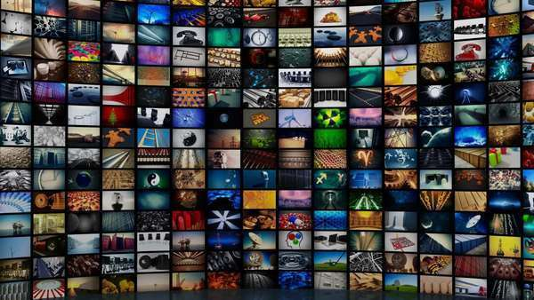 Multichannel curved display of colorful footages/media screens in a montage at an exhibition. Royalty-free stock video