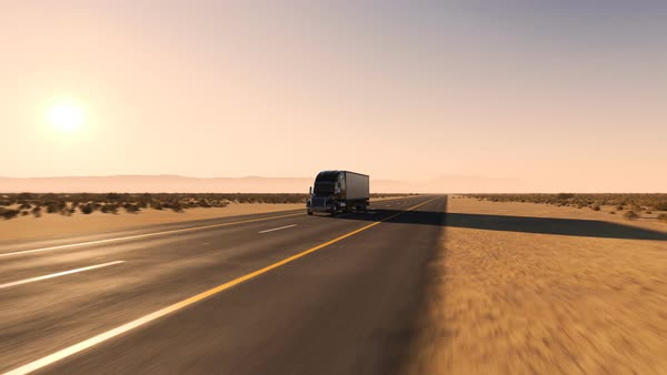 Camera moving along the semi-trailer truck on a desert road. Royalty-free stock video