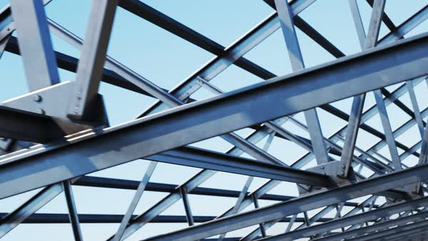 Camera moving along the loopable steel roof truss on a clear sky background. Royalty-free stock video