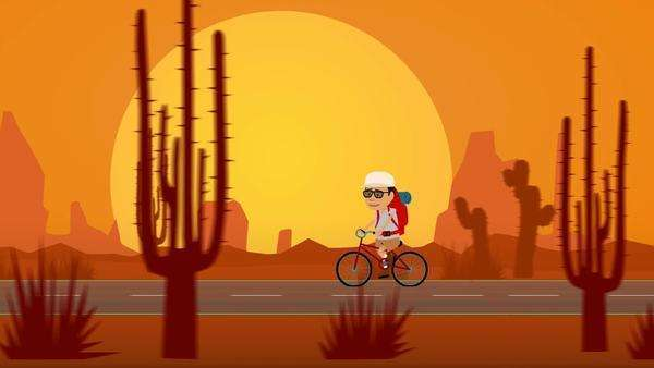 Tourist Travelling On Bicycle In Desert With Sun And Rock Formations In Background Royalty-free stock video