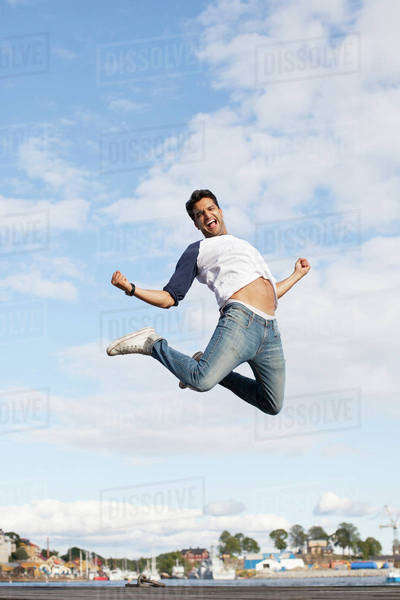 Excited young man jumping in air Royalty-free stock photo