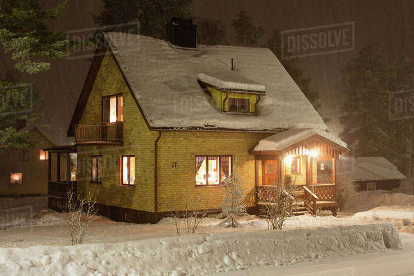 Illuminated house covered in snow during Christmas Royalty-free stock photo