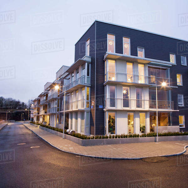 Exterior of residential building with empty street at dusk Royalty-free stock photo
