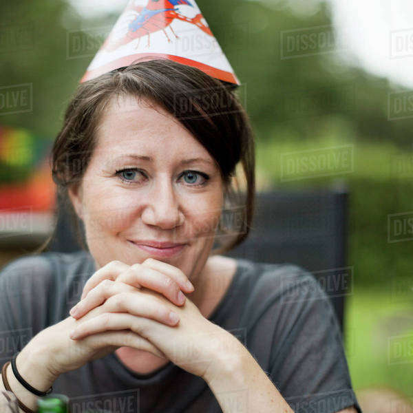 Mid adult woman celebrating crayfish party in lawn Royalty-free stock photo