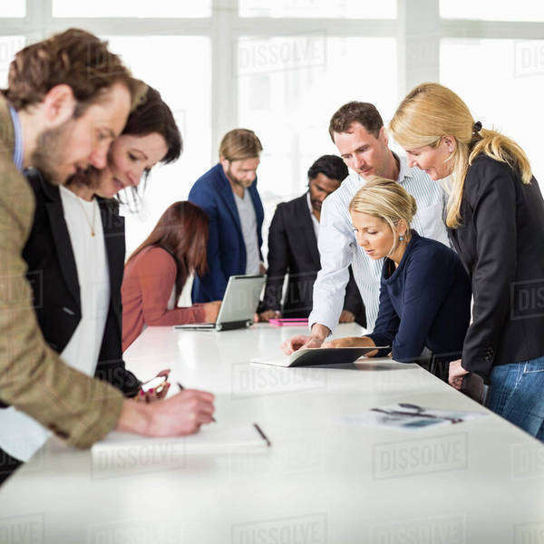 Group of business people working together at desk in office Royalty-free stock photo