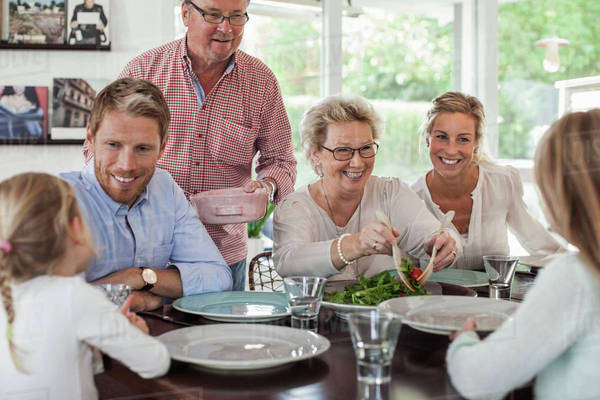 Multi-generation family having lunch together at home Royalty-free stock photo