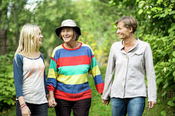 Happy three generation females at park Royalty-free stock photo