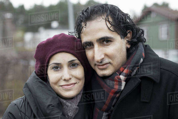 Portrait of smiling couple outdoors in winter Royalty-free stock photo