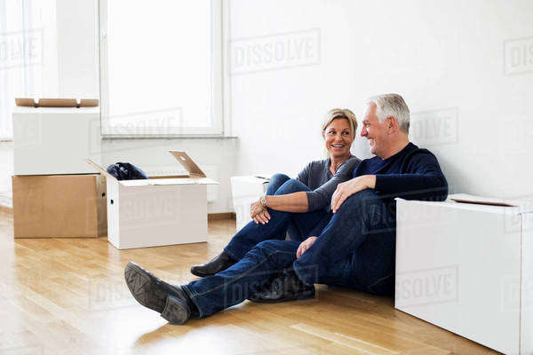Mature couple relaxing after moving into their new house Royalty-free stock photo