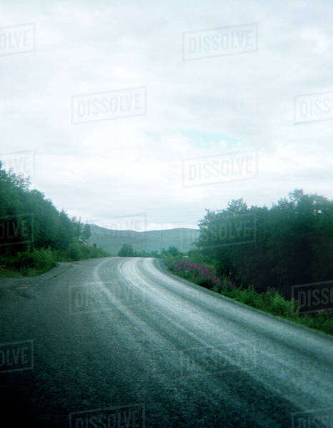 Road disappearing round the corner Royalty-free stock photo