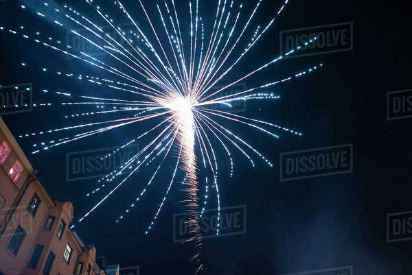 Low angle view of fireworks exploding against sky at night Royalty-free stock photo