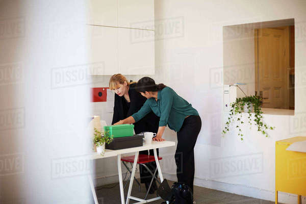Mid adult businesswoman having discussion at table in office Royalty-free stock photo