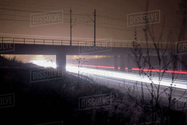 Long exposure of traffic lights under bridge at night Royalty-free stock photo