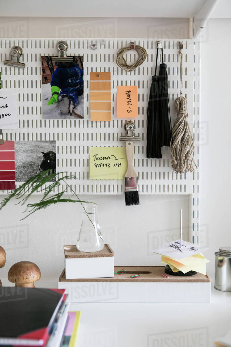 Various Objects Hanging On Pegboard At Home Office