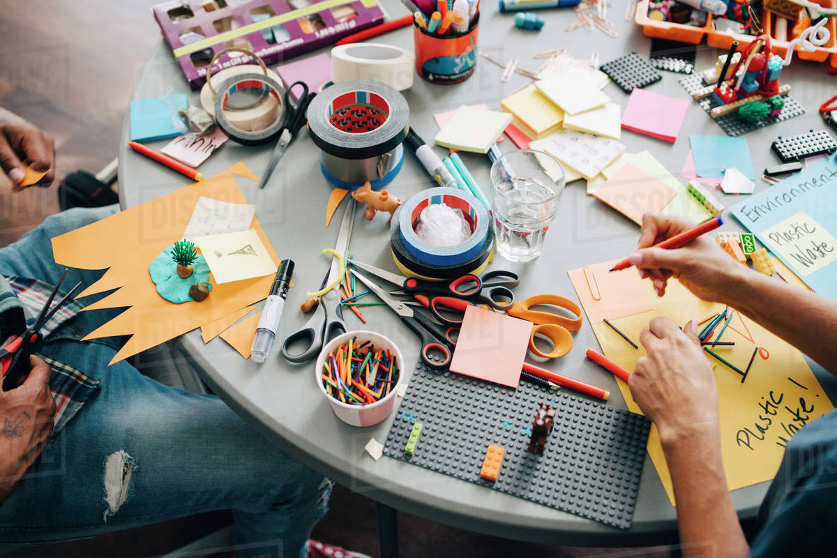 High angle view of colleagues working at table in creative office Royalty-free stock photo