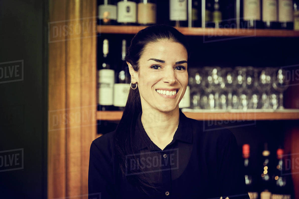 Portrait of smiling owner standing in cafe Royalty-free stock photo