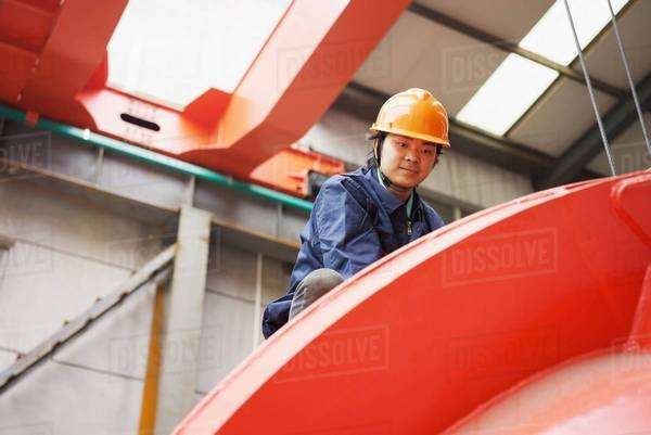 Worker in crane manufacturing facility, China Royalty-free stock photo