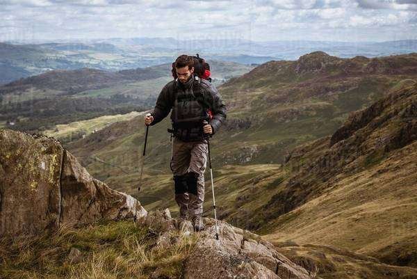 Young male hiker moving up mountain, The Lake District, Cumbria, UK Royalty-free stock photo