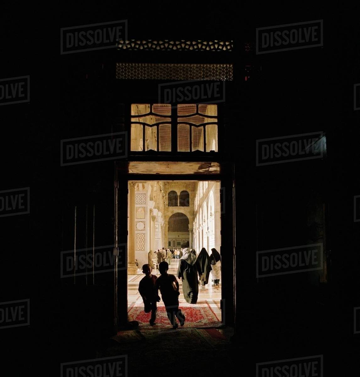 Worshippers inside the Umayyad Mosque, the Grand Mosque of Damascus, in  Damascus, Syria stock photo