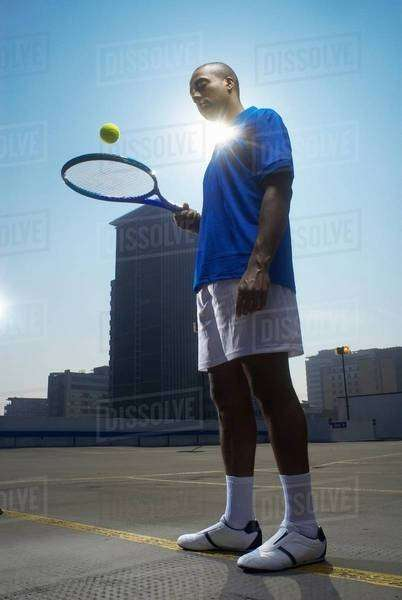 Tennis player on rooftop court Royalty-free stock photo
