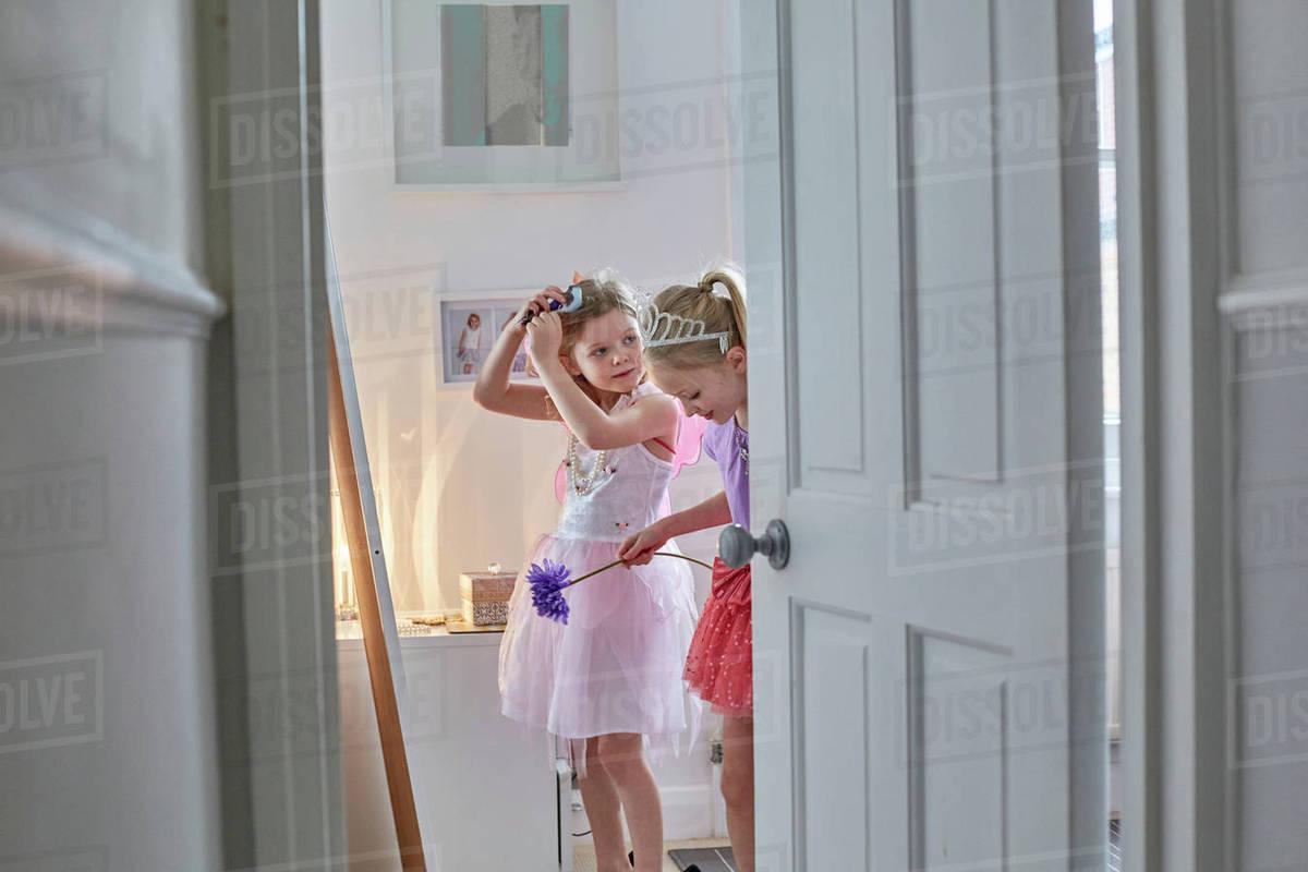 Girls in costume behind open door Royalty-free stock photo