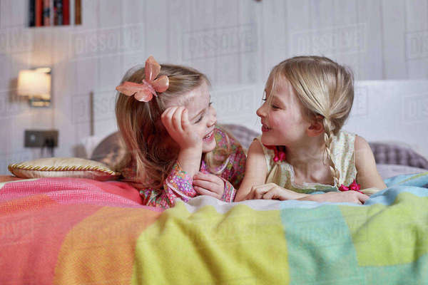 Girls lying on bed Royalty-free stock photo