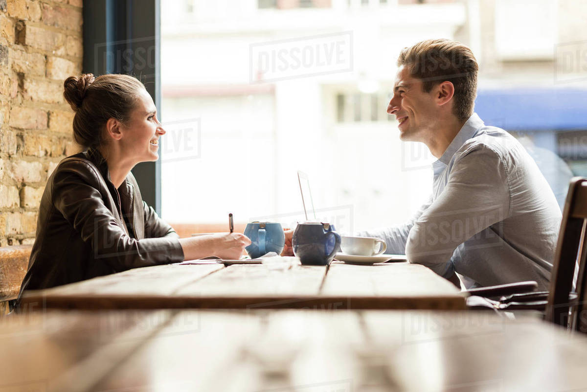 Young businessman and woman meeting in cafe Royalty-free stock photo