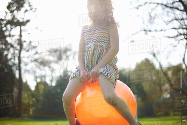 Young girl bouncing on inflatable hopper Royalty-free stock photo