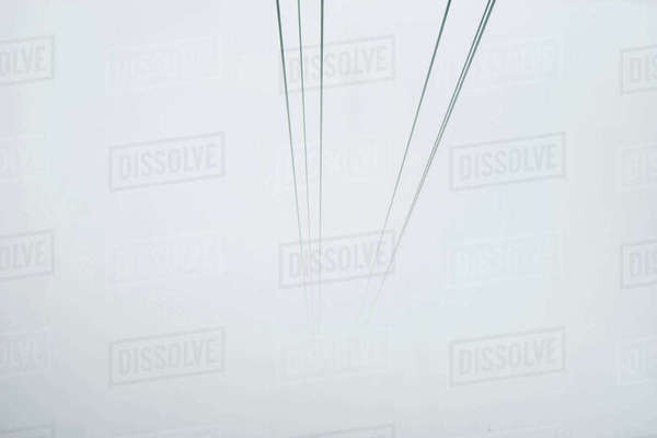 Cable car cables disappearing into mist, Mount Pilatus, Switzerland Royalty-free stock photo