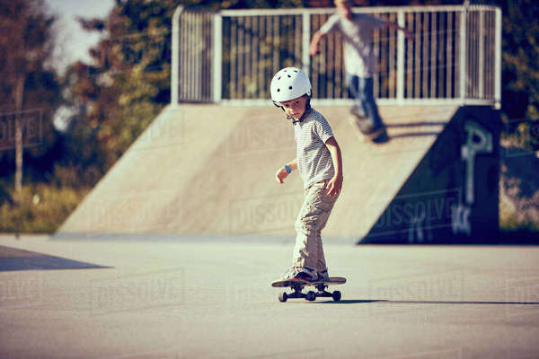 Boy skateboarding in park Royalty-free stock photo
