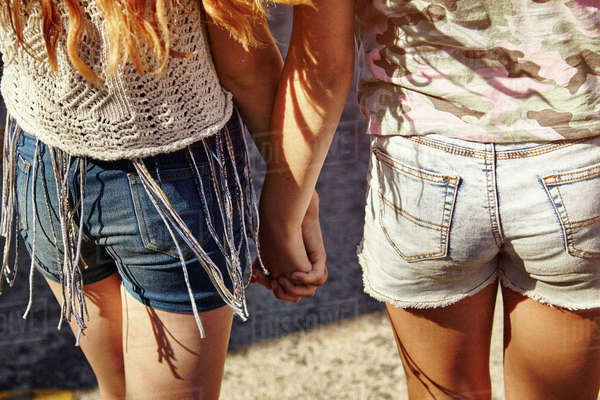 Teenage girls in street, rear view of shorts and hands Royalty-free stock photo
