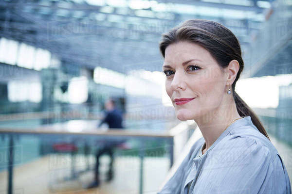 Businesswoman waiting on office balcony Royalty-free stock photo