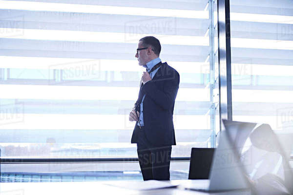 Businessman looking out of office window Royalty-free stock photo