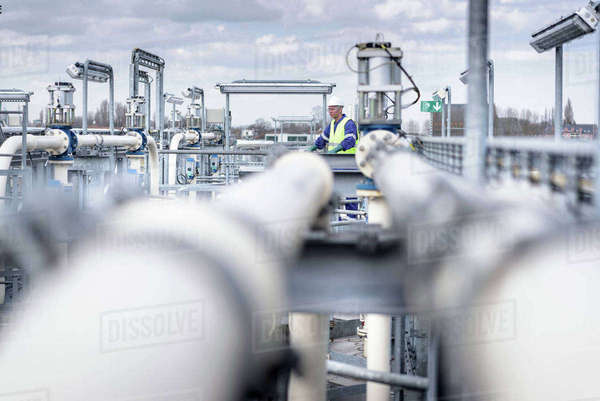 Worker on top of process plant in oil blending factory Royalty-free stock photo