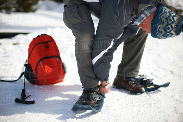Man putting on snowshoes, Lake Louise, Canada Royalty-free stock photo