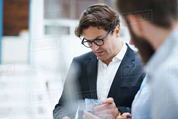 Interior design team looking at swatch in design studio Royalty-free stock photo