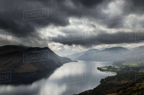Storm clouds over Ullswater lake, seen from Gowbarrow Fell, The Lake District, UK Royalty-free stock photo