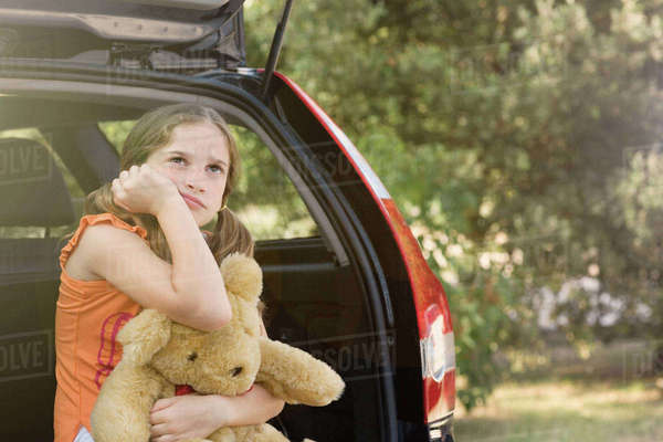 Sullen girl with teddy bear Royalty-free stock photo