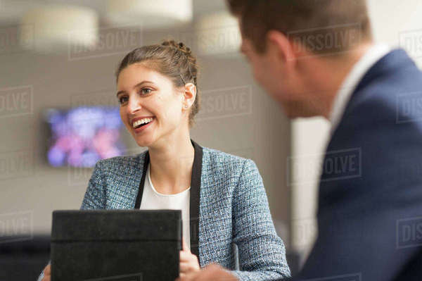 Businesswoman meeting male colleague in boardroom Royalty-free stock photo